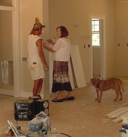 Susan reviewing work with the painter Ray, and Yogi.